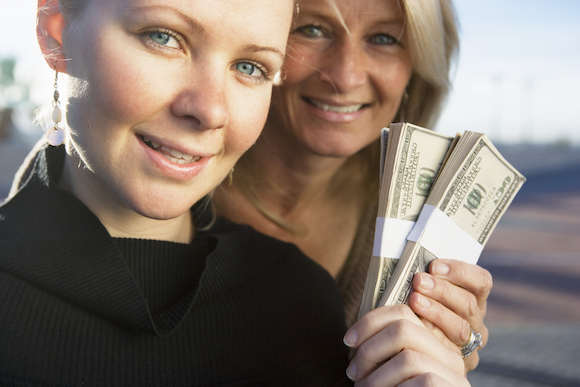 Mother and Daughter with Cash