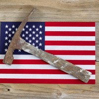 United States of America flag and  hammer on rustic wood