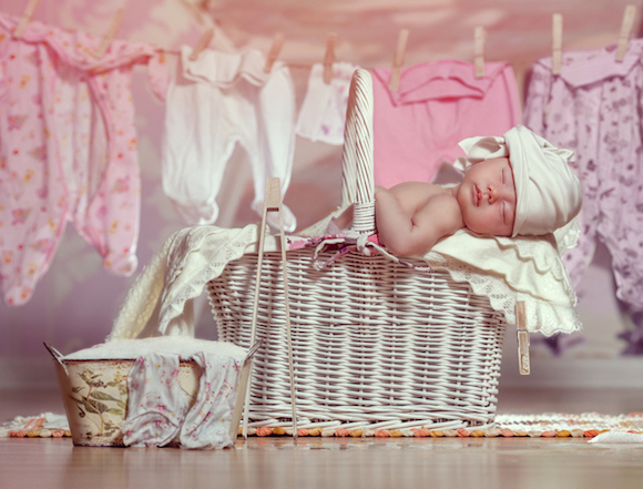 Newborn sleep after helping her mother in the laundry washing