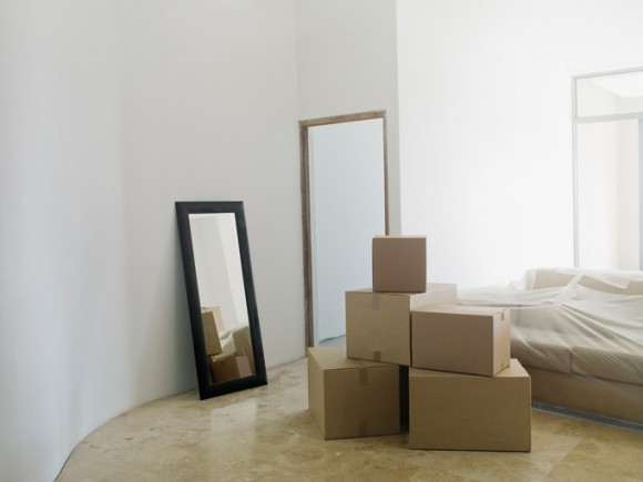 Cardboard boxes and mirror in new house
