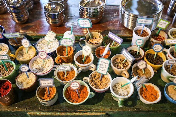Indian Spice Bowls on a Wooden Table with Labels