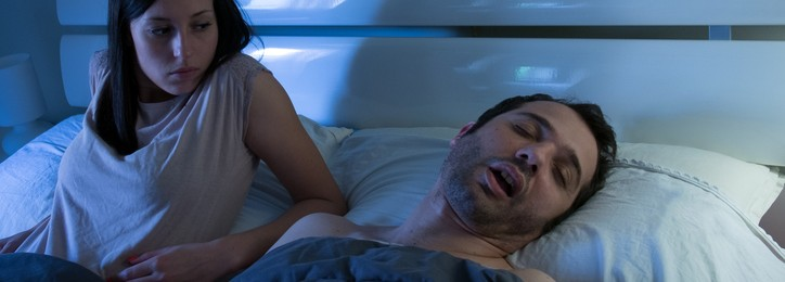 Woman worried and sleepless because his man is snoring loudly