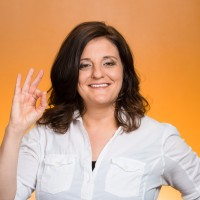 Closeup portrait middle aged happy smiling excited natural woman giving OK sign