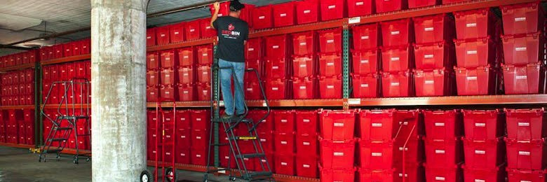 Valet storage containers fill a warehouse wall operated by Brooklyn-based Red Bin.